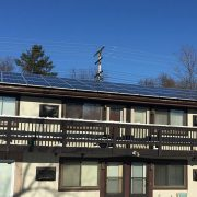 Housing initiatives building with solar panels