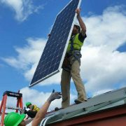 Individual solar panel going up on the TB Scott Library roof