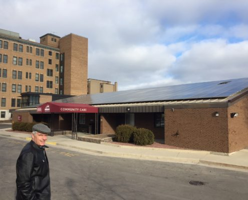 Tony of LSC in front of St. Joseph's Convent's new solar array (The School Sisters of St. Francis)