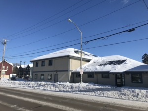 Snow-covered Literacy Network solar panels