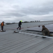 Full Spectrum Solar Installers on the Rooftop of Oregon Ice Arena