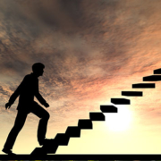 Man climbing stairs with sunrise background