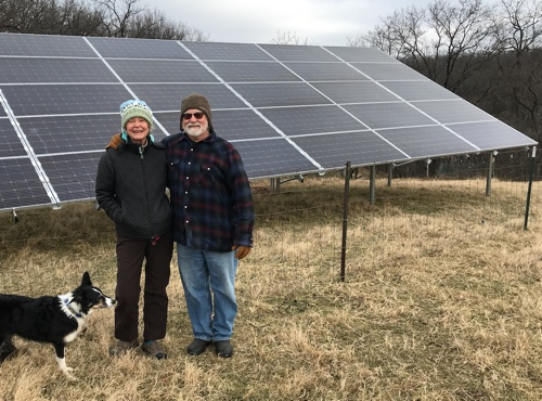 Trisha McConnell and Jim Billings in front of their solar installation