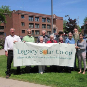Ribbon cutting with Legacy Solar Co-op banner
